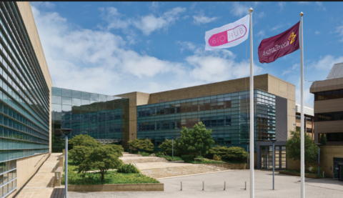 Exterior of Alderley Park with BioHub and AstraZeneca flag