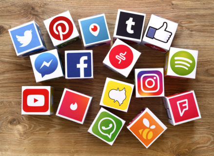 cubes containing logos for various social media platforms including twitter, facebook, instagram and snapchat