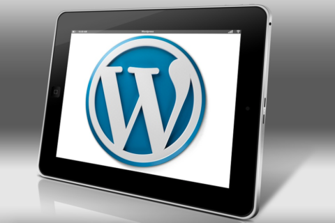 tablet with wordpress logo on