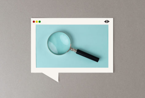 white box containing a magnifying glass to illustrate why your small business needs seo