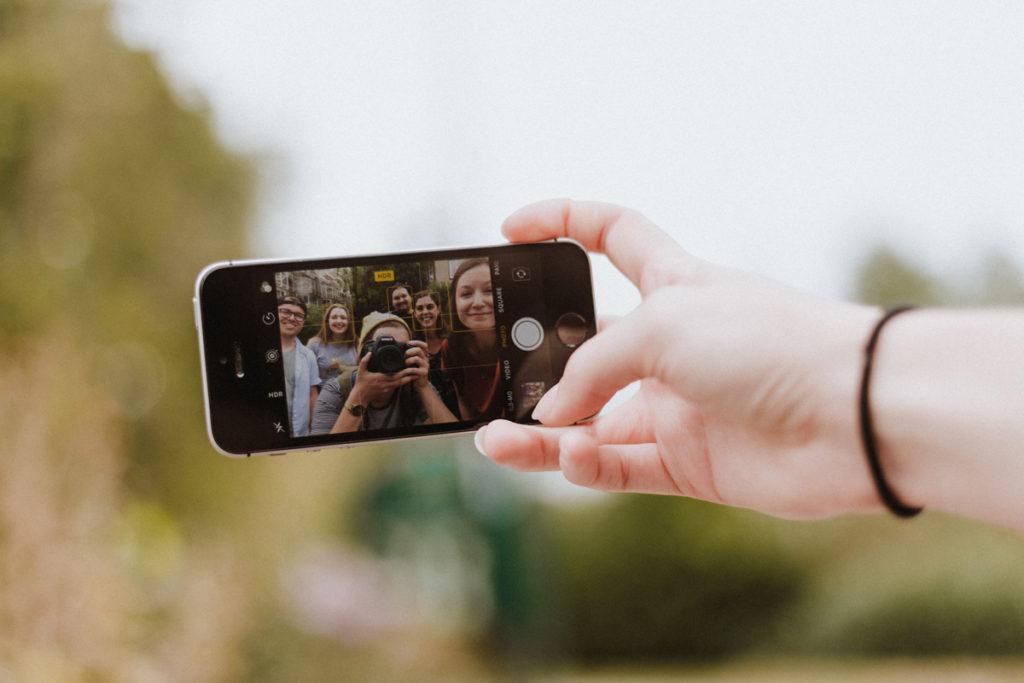 smartphone showing selfie of millennials