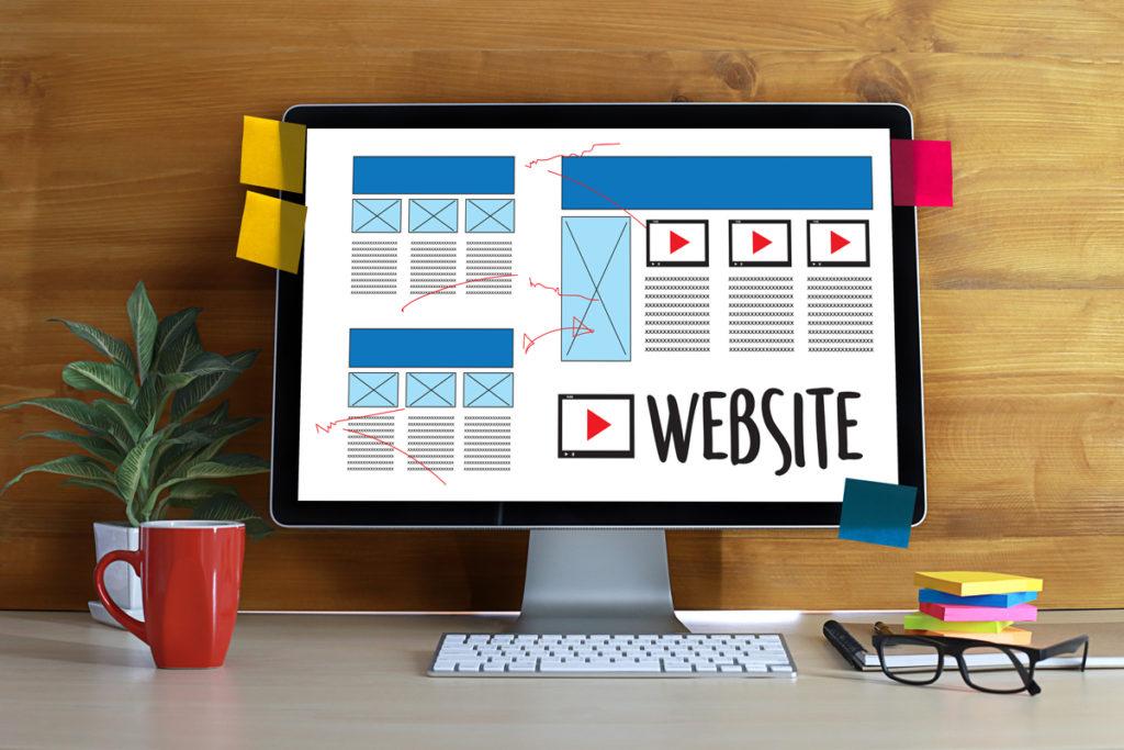 apple mac screen showing design of a website
