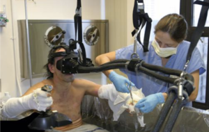 burn patient being treated while using Virtual Reality headset