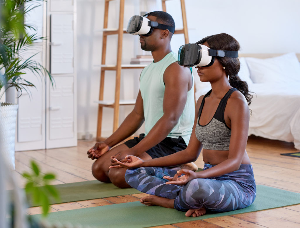 couple meditating using VR headsets
