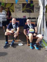 ian and stuart from pier2pier relaxing after their marathon