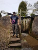 Stuart standing next to the Trent Mersey Canal