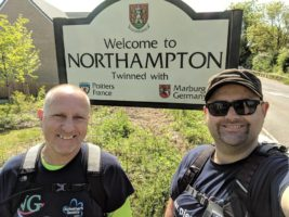 Ian and Stuart next to a Northampton sign