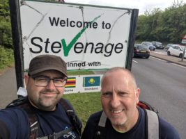 Ian and Stewart next to a Stevanage sign