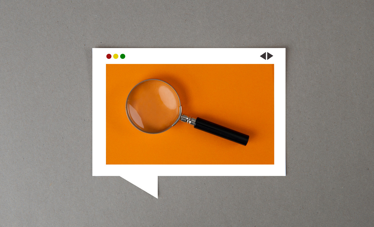 beginners guide to search engine results pages features - a magnifying glass on an orange background
