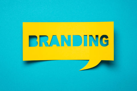 the word branding in yellow on a turquoise background